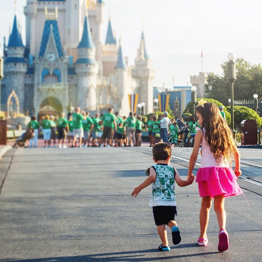 Two kids walking up to Disney Castle in Magic Kingdom