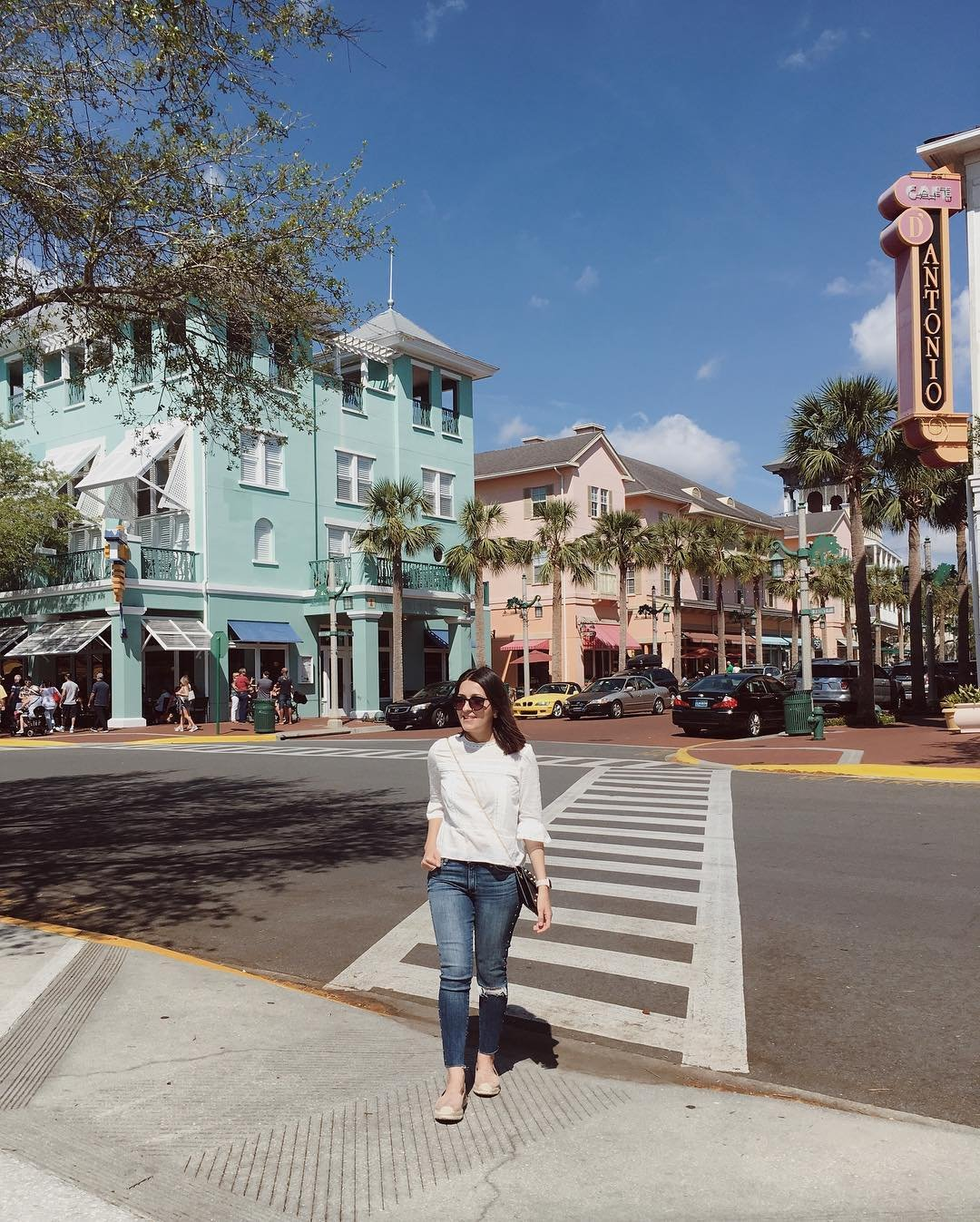 A woman walks through Downtown Celebration