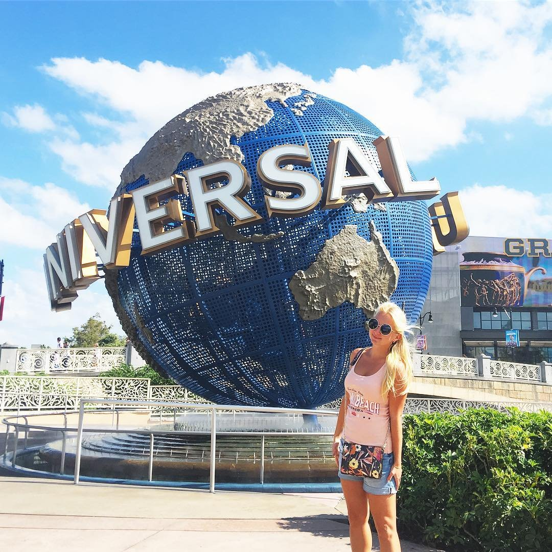 A woman poses in Universal Studios