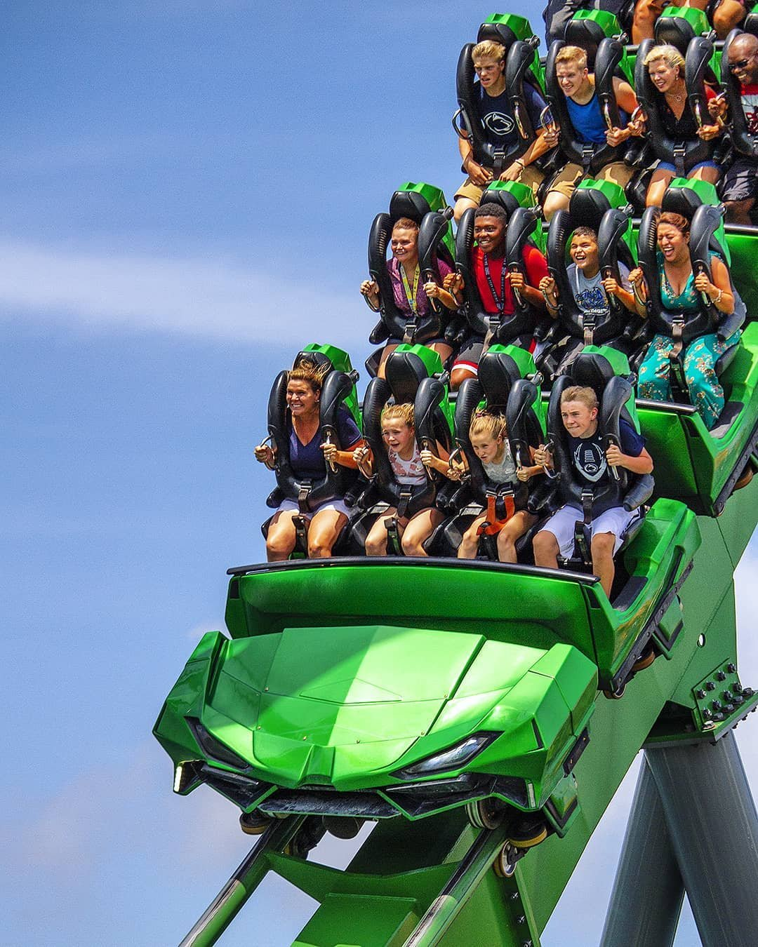 Vacationers enjoy the Incredible Hulk Coaster