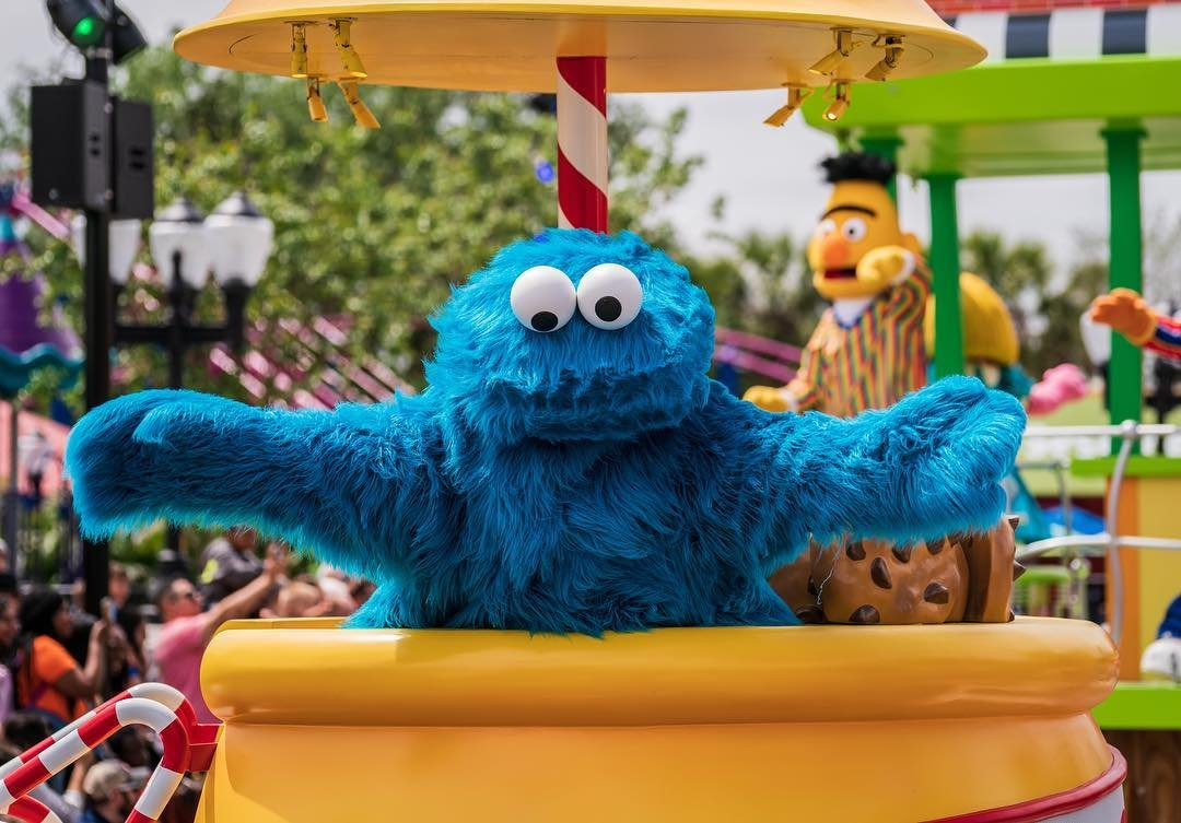 Cookie Monster waves to his fans