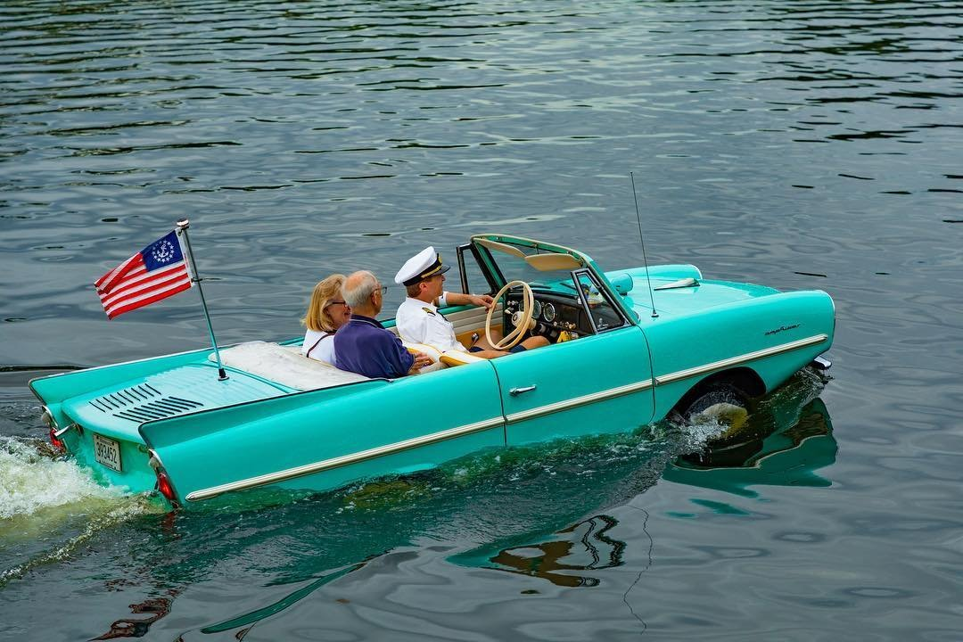 A couple rides in a amphicar