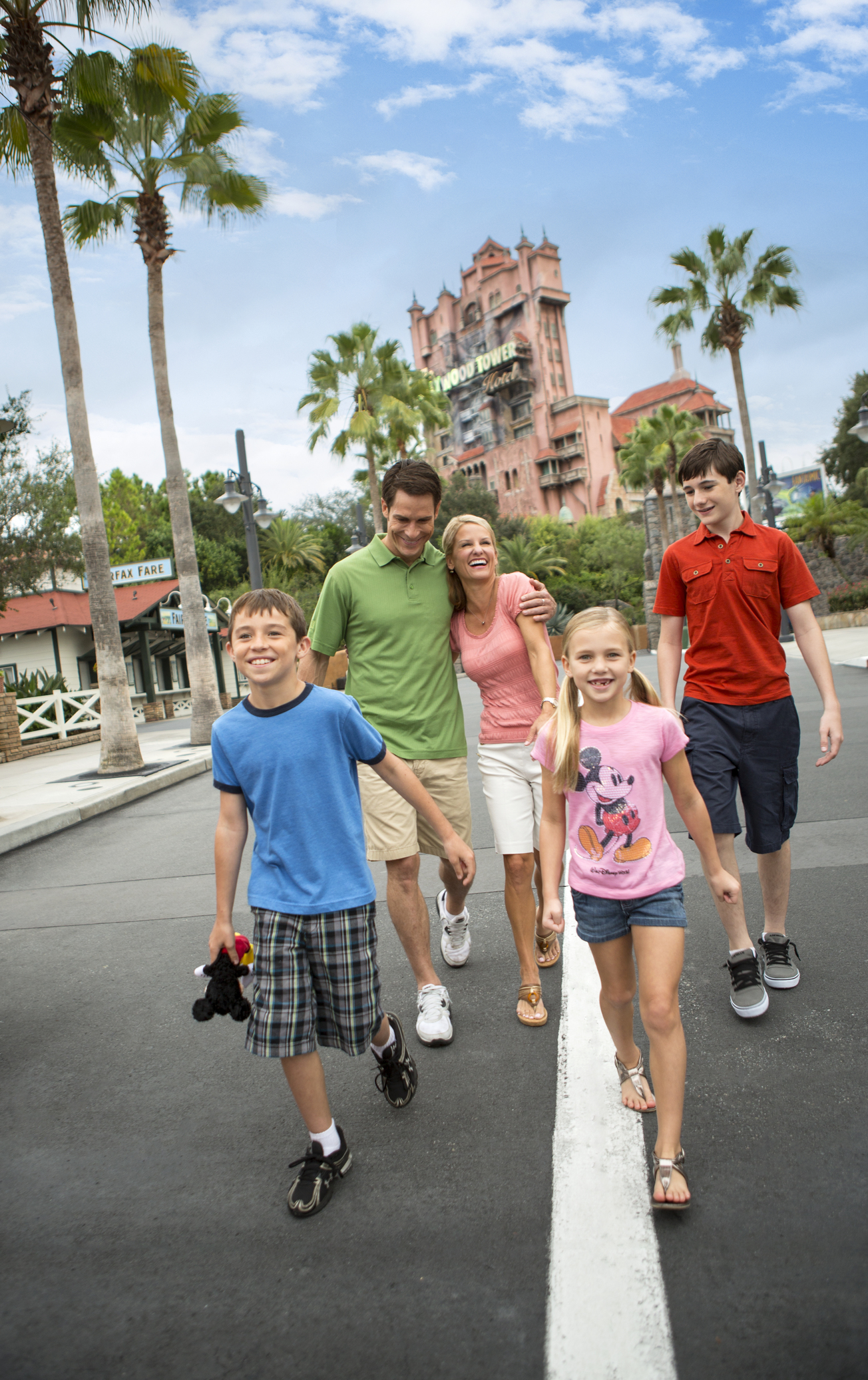 A Family walks outside the Tower of Terror