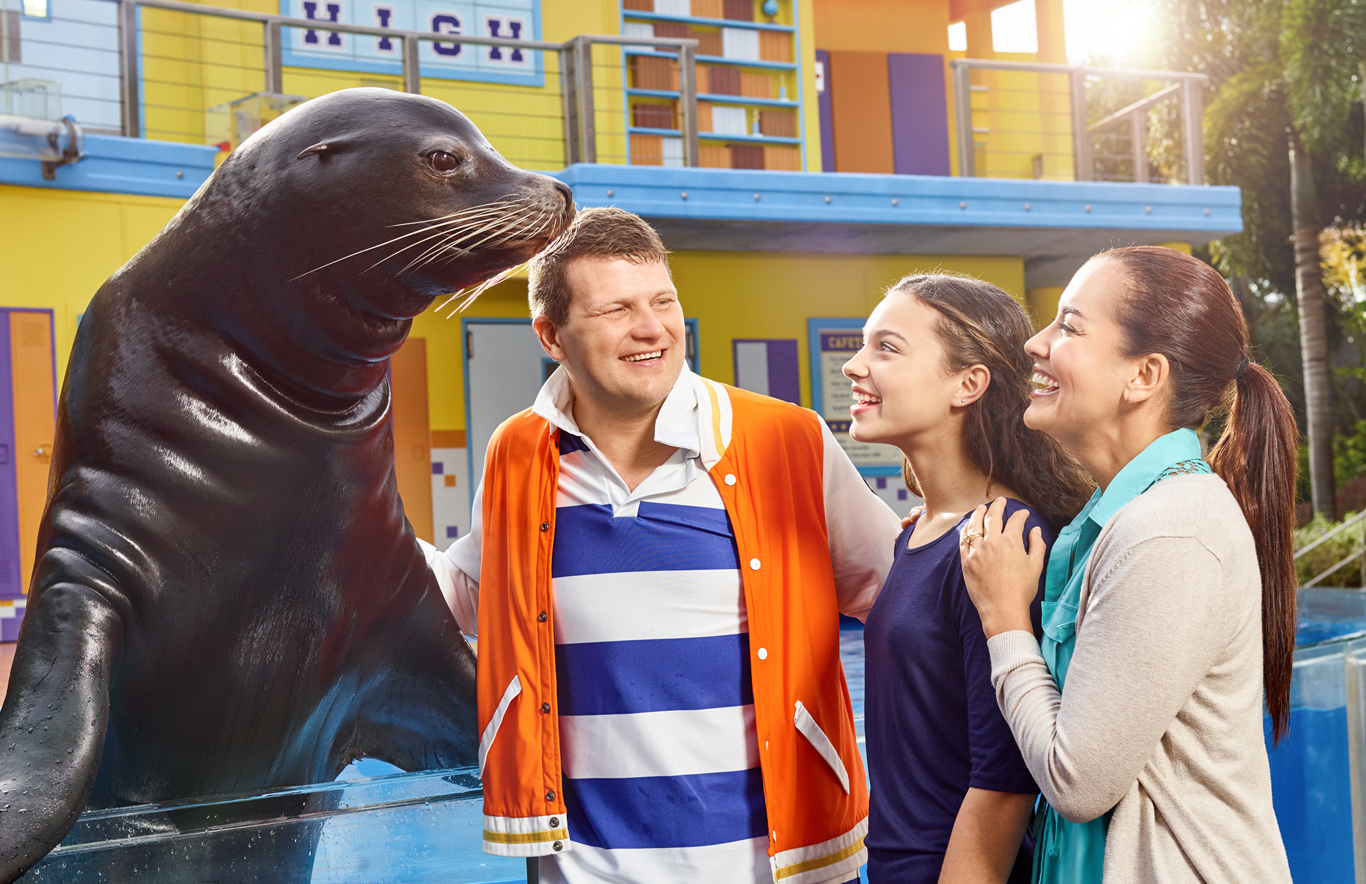 A family interacts with a rehabilitating animal at SeaWorld
