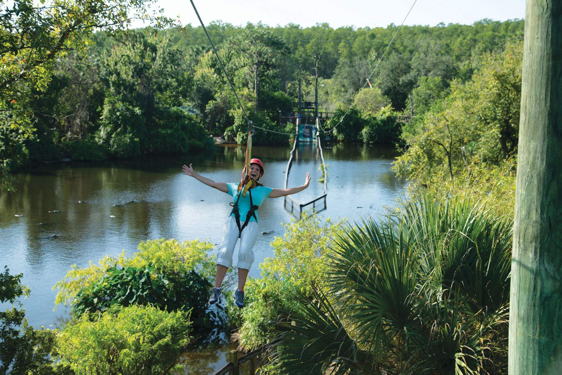 A woman prepares to ride the Screamin' Gator Zip Line at Gatorland