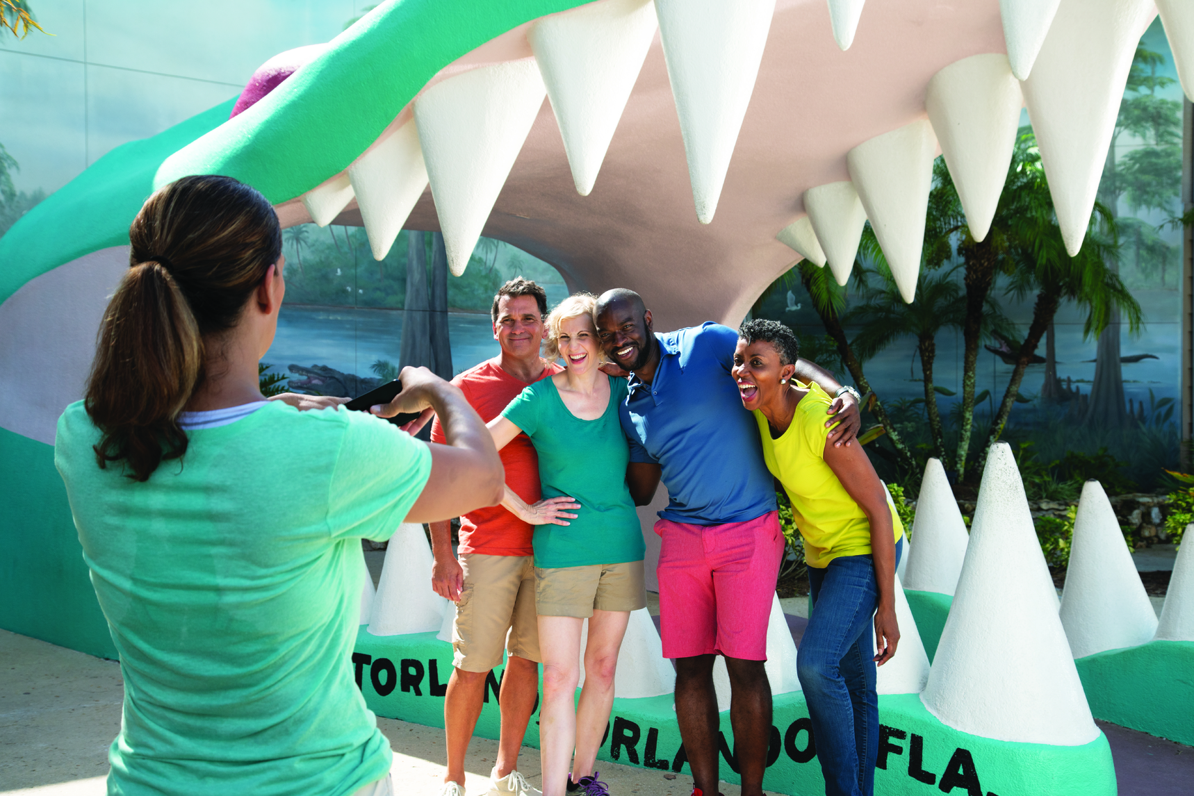 Friends pose outside Gatorland