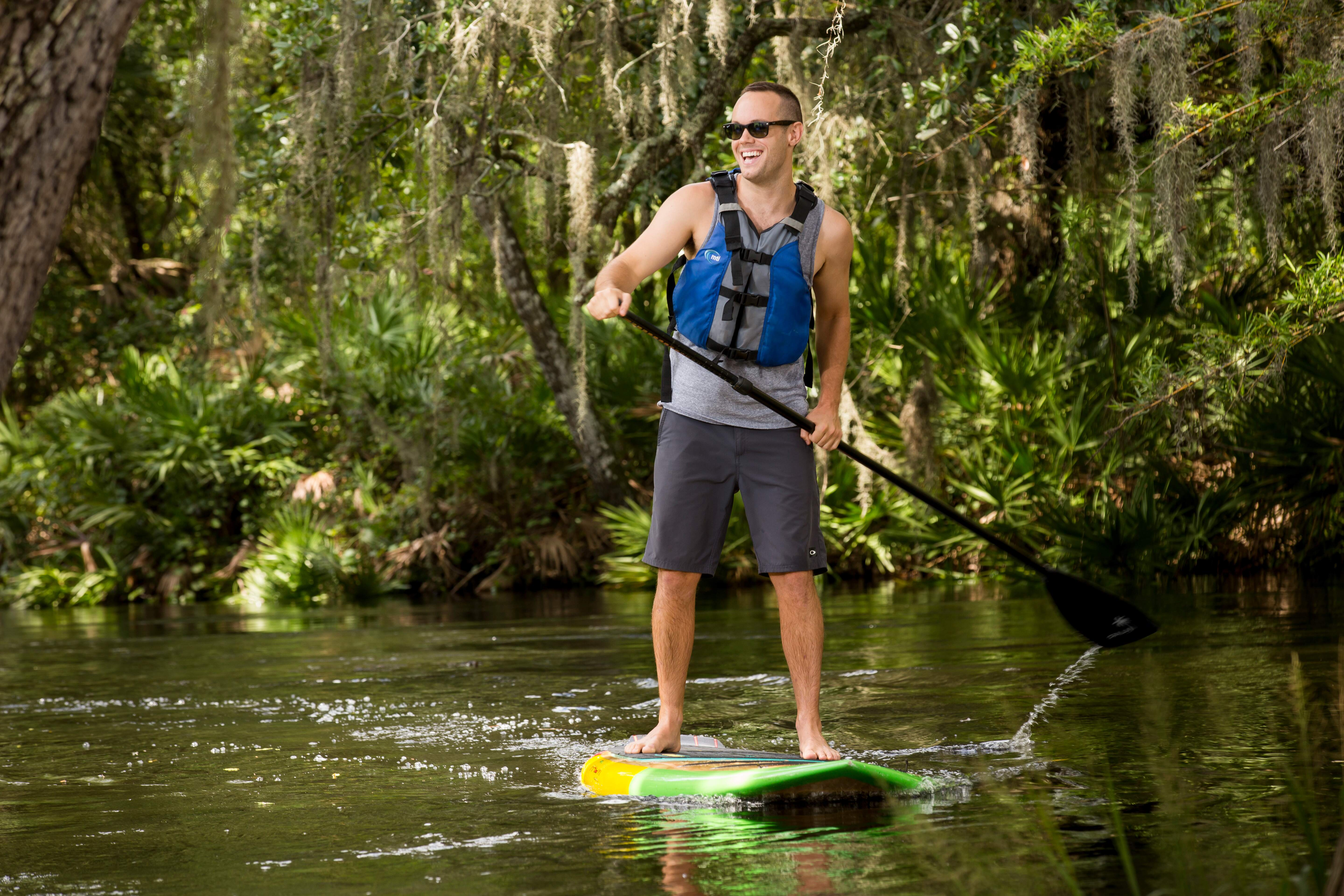 Stand up paddleboarding at Shingle Creek in Kissimmee, Florida.