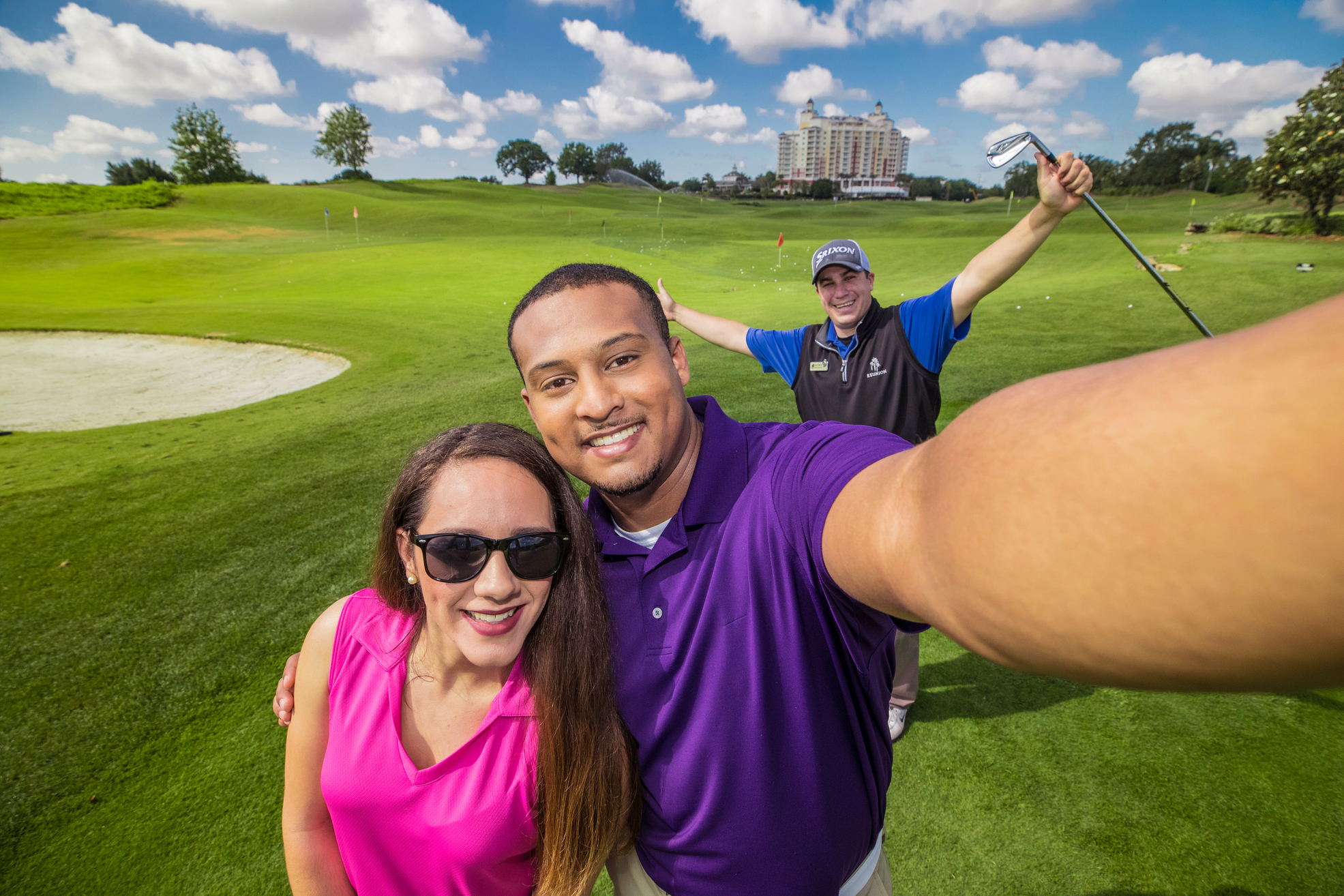 A couple takes a selfie on the golf course
