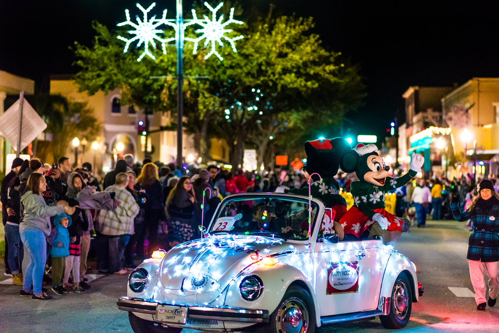 A car drives in the Kissimmee Festival of Lights Parade