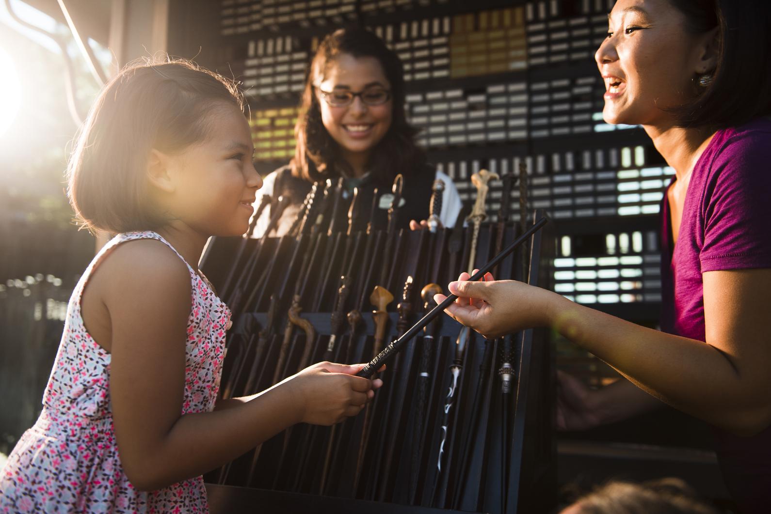 A little girl receives her wand