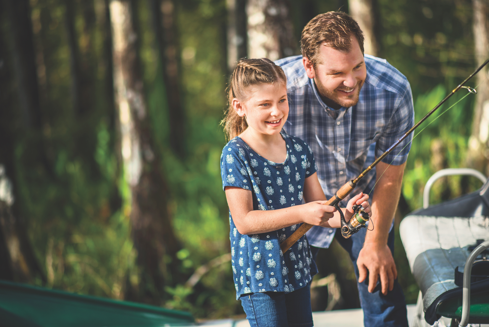 A father and daughter go fishing in Kissimmee, Florida