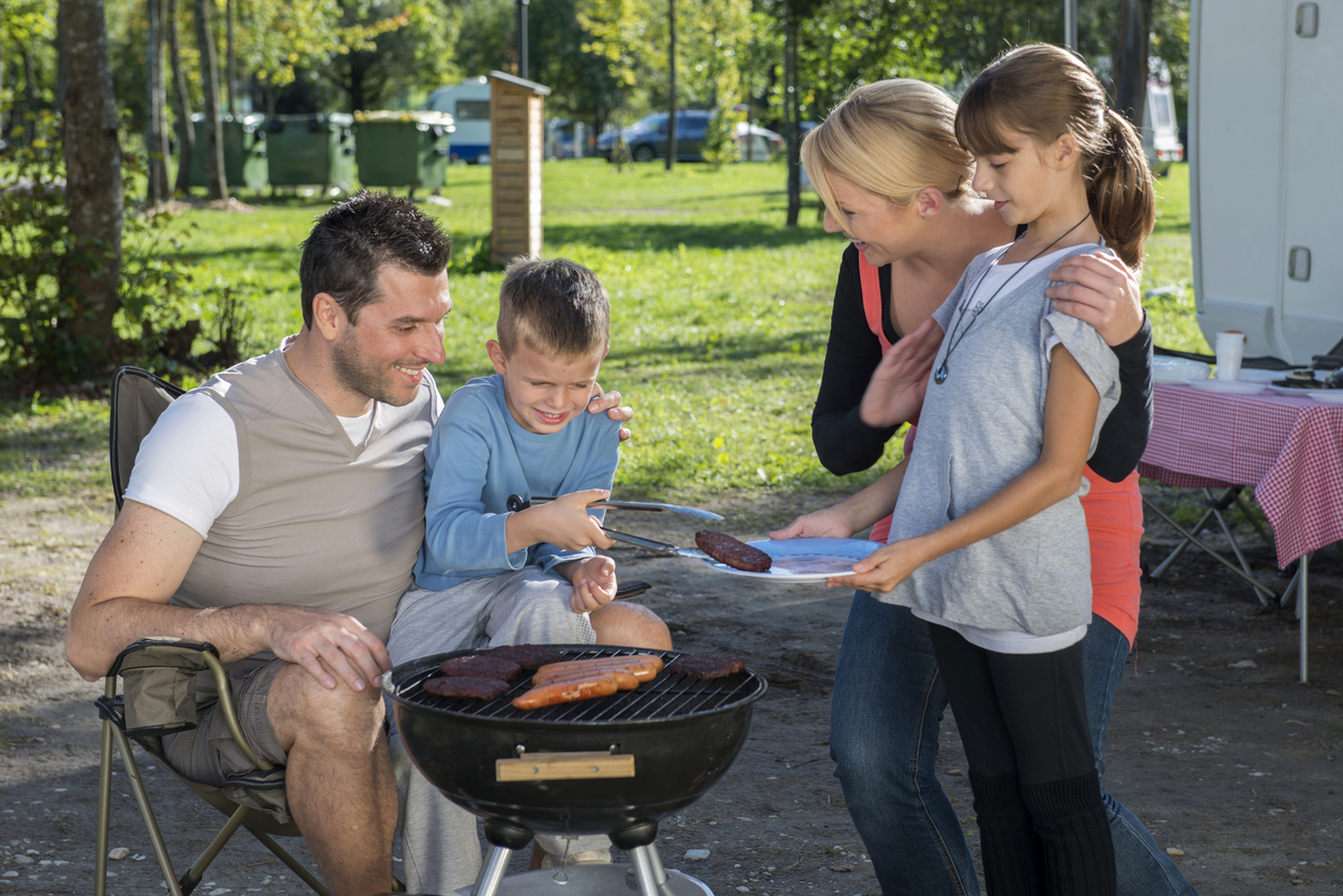 A family has a barbecue at a campground in Kissimmee