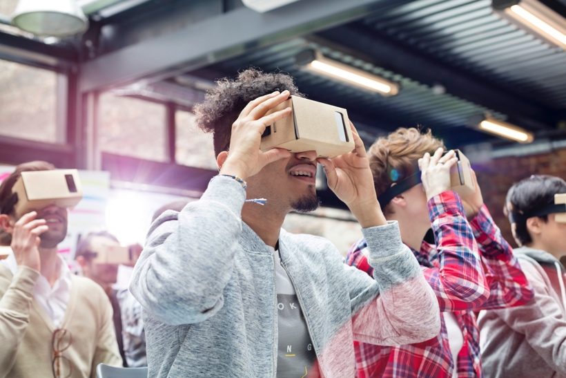 Group of people using AR technology at a conference