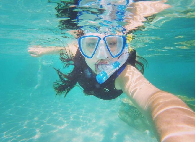 A woman snorkeling at Discovery Cove in Kissimmee