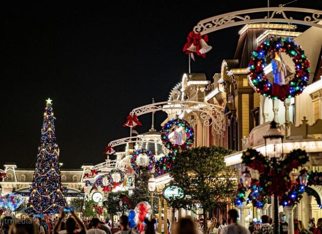 Main Street U.S.A. with Christmas decorations at night