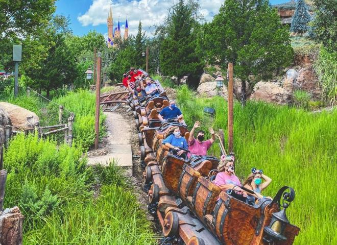 People ride a rollercoaster at Disney's Magic Kingdom Theme Park
