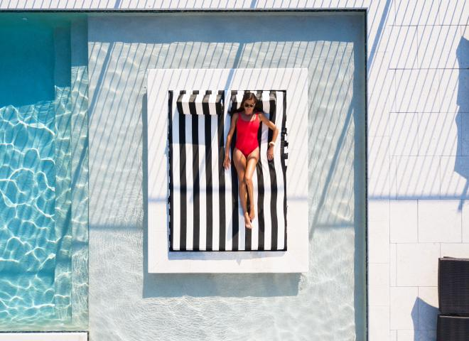 Woman on pool bed