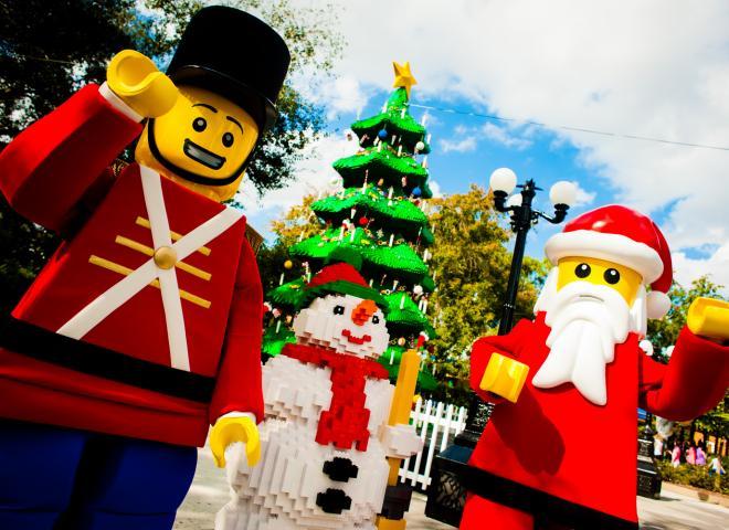 Christmas characters wave at the camera at LEGOLAND Florida Resort