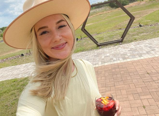 Angela Jones takes a selfie at the Island Grove Wine Company