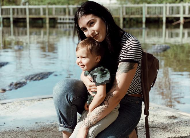 Izzy Rose poses with her child at Gatorland
