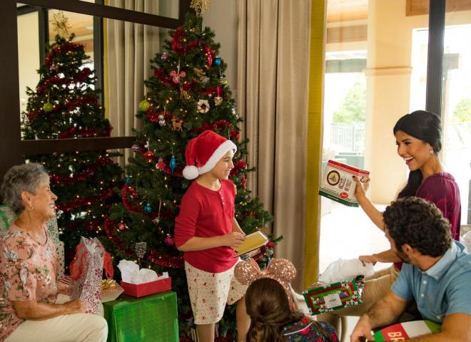 A family opens presents at their vacation home