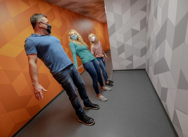 A family explores the Museum of Illusions