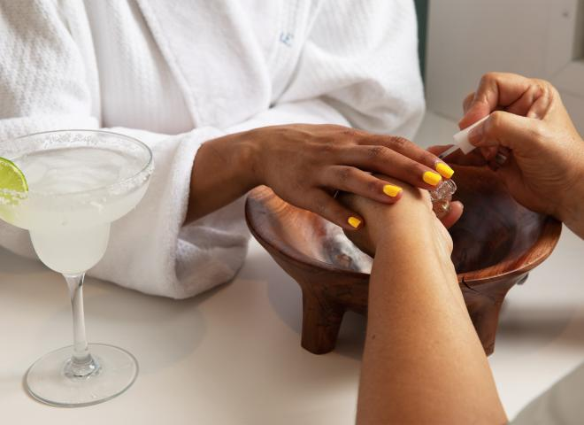 Close up of a woman receiving a manicure at the St. Somewhere Spa Margaritaville in Kissimmee, Florida