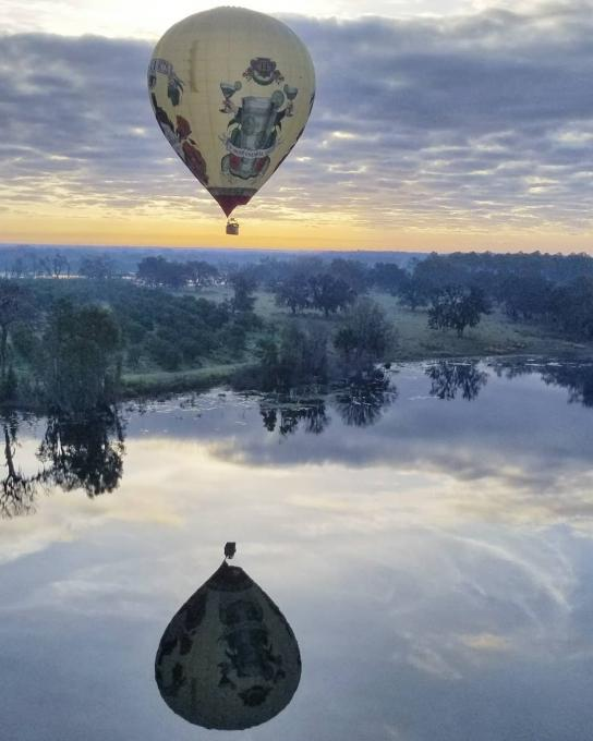 A hot air balloon floats over a lake in Kissimmee, Florida
