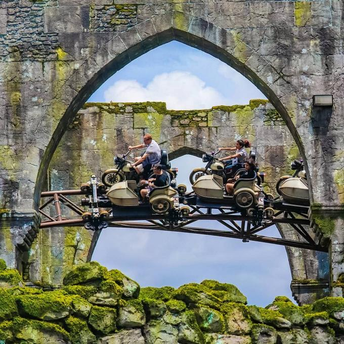 Guests ride Hagrid's™ Magical Creatures Motorbike Adventure