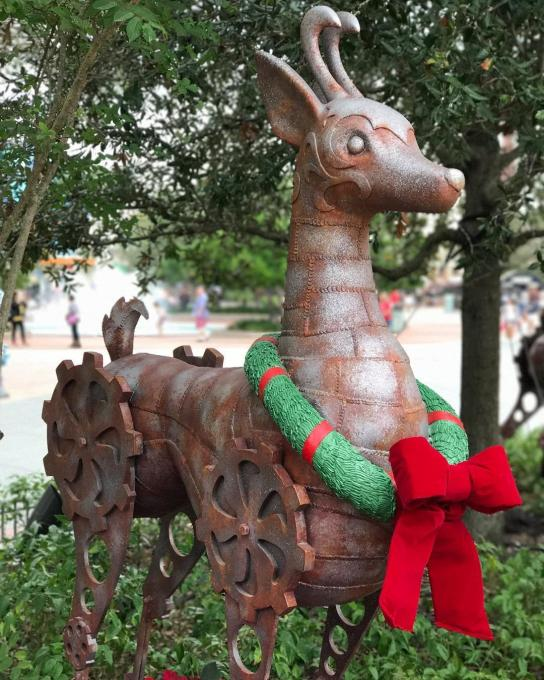 A reindeer with a wreath around its neck