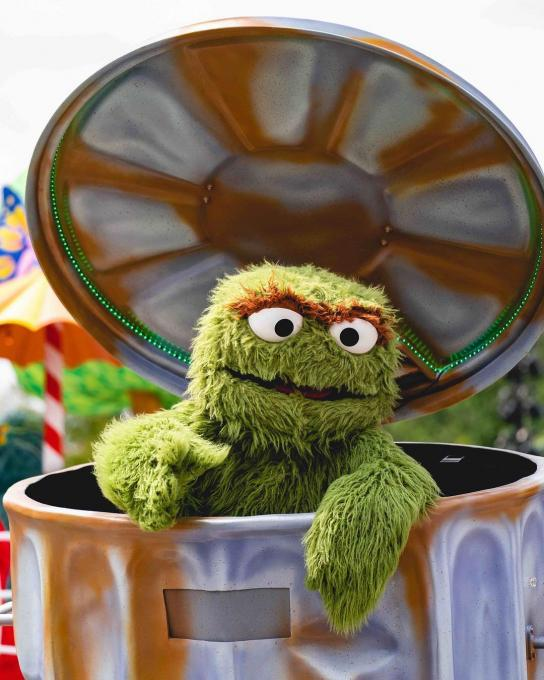 Oscar the Grouch participates in a parade