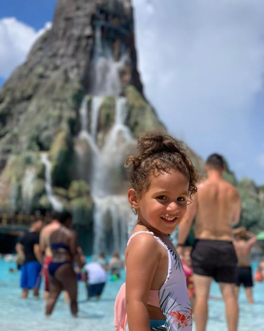 A little girl smiles at Universal's Volcano Bay