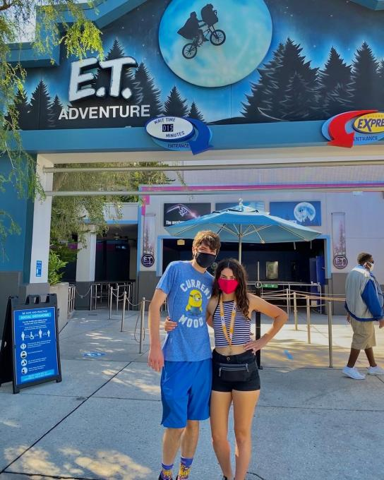 Friends stand outside ET Adventure