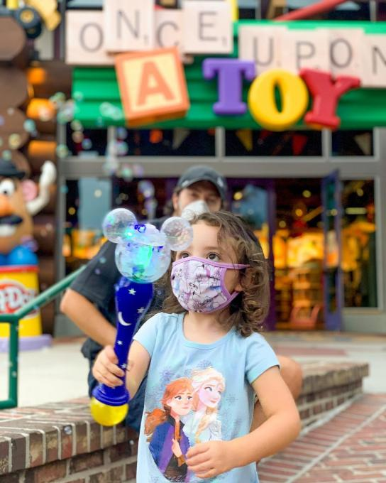 A child plays at Disney Springs