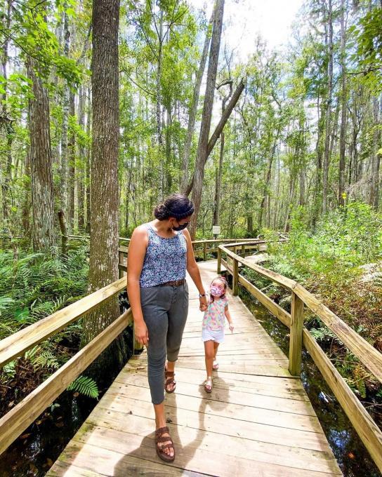A woman and her child walk through Gatorland