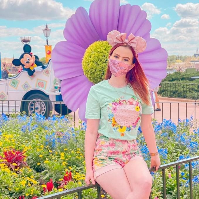 A woman poses at the Epcot International Flower and Garden Festival