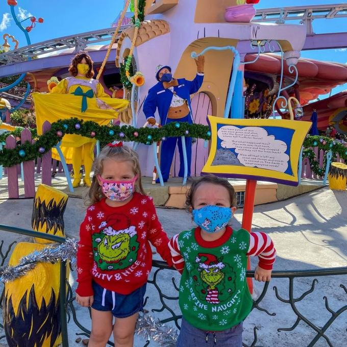 Children pose in Whoville during the holiday season at Universal Studios