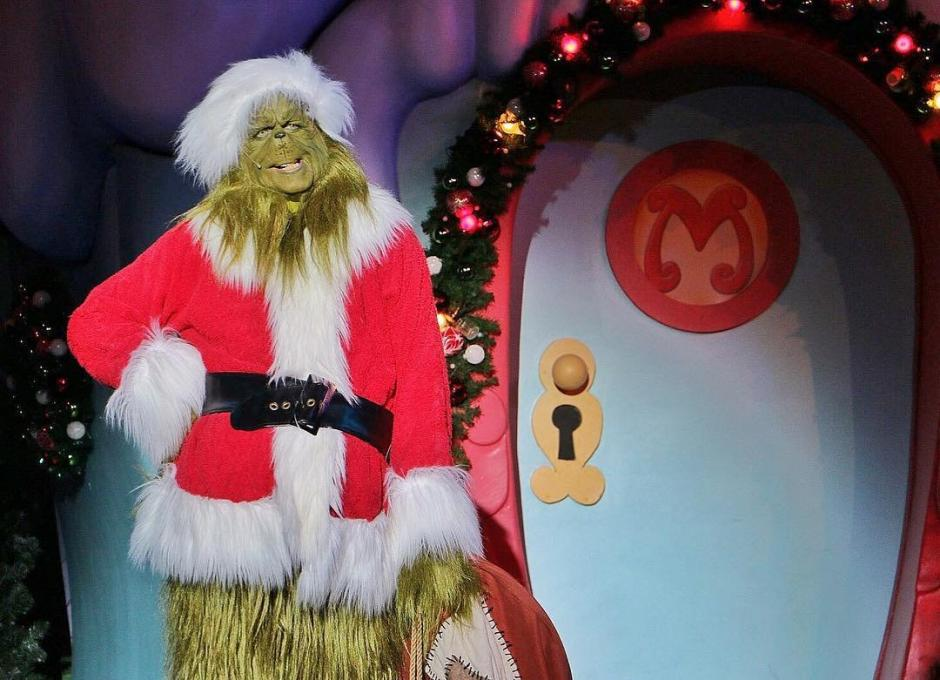 The Grinch performs at The Grinchmas Who-liday Spectacular