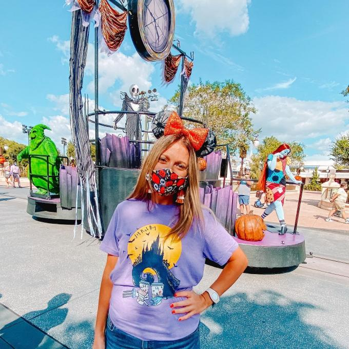A woman wears a Halloween face covering at the Magic Kingdom