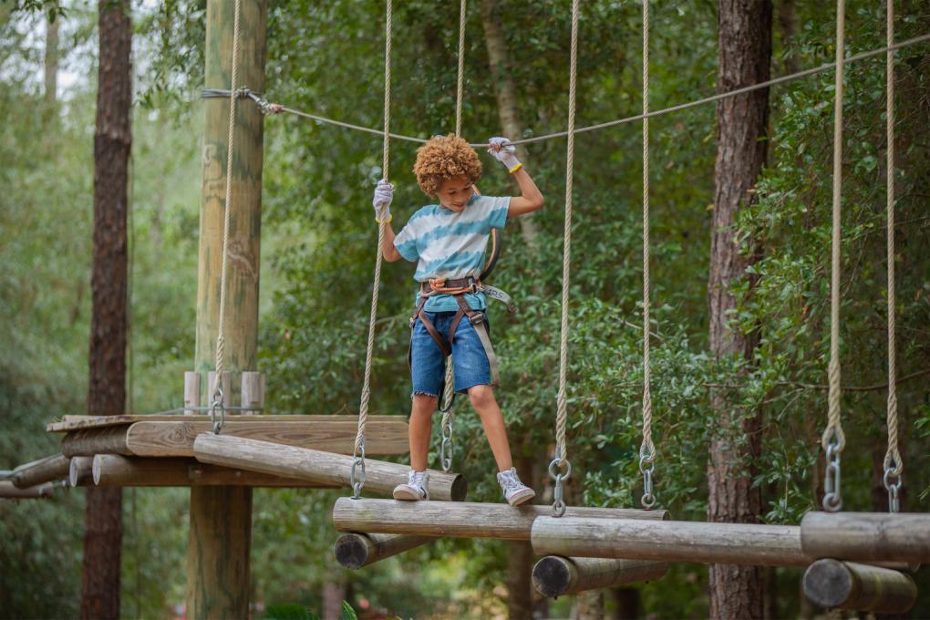 A child plays at Orlando Tree Trek Adventure Park