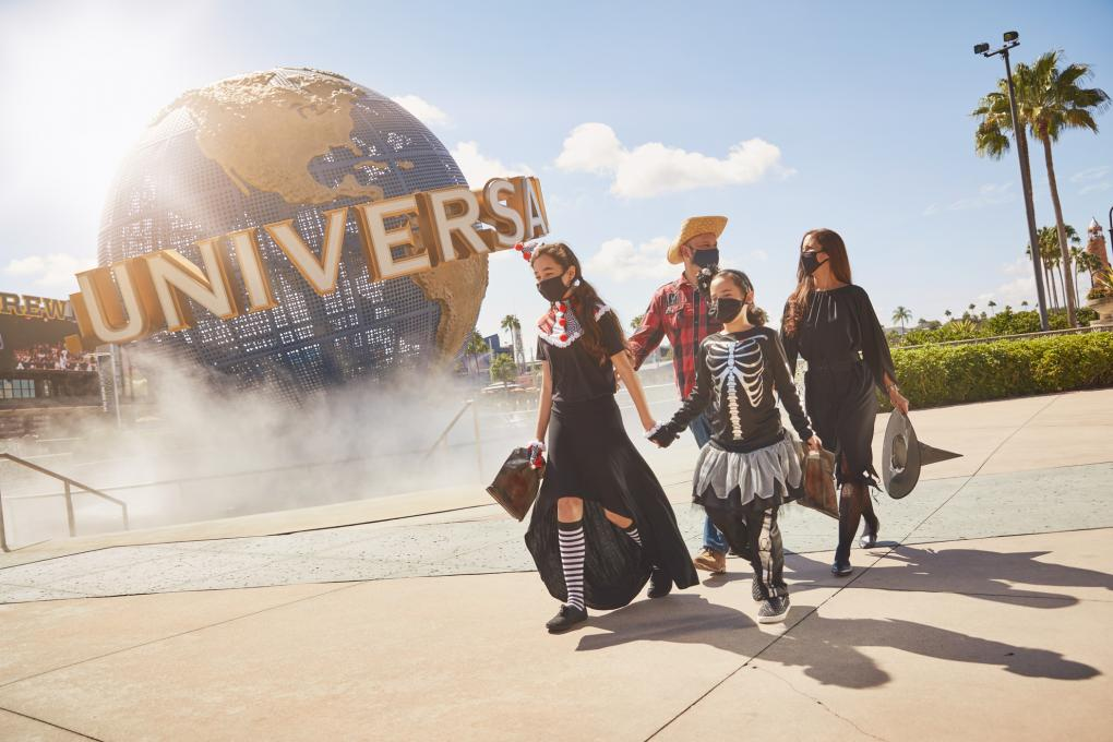 A family dresses in costumes at Universal Studios Florida