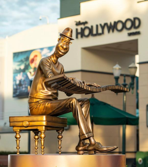 Mini Golden Statue in front of Hollywood Studios Sign, Disney