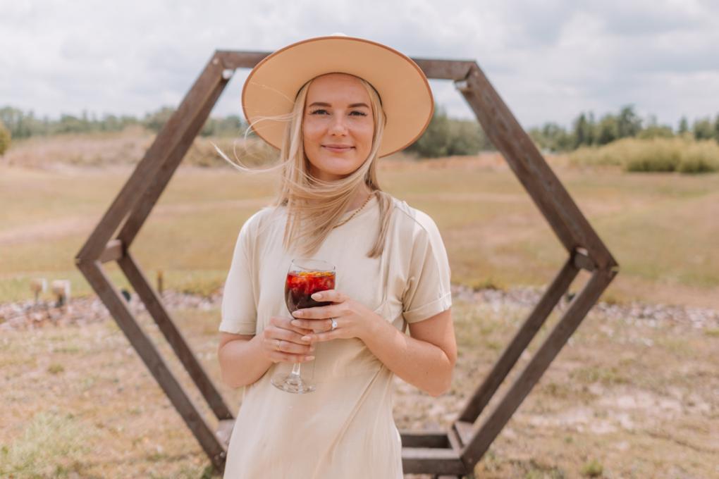 Angela Jones holding a glass