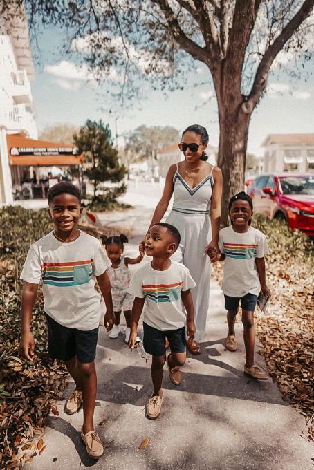 A family walks by Celebration Bike Rental in Kissimmee