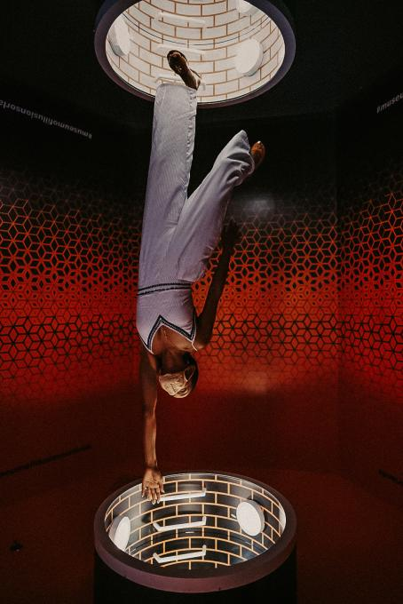 A woman inside an exhibit at Museum of Illusions in Kissimmee.