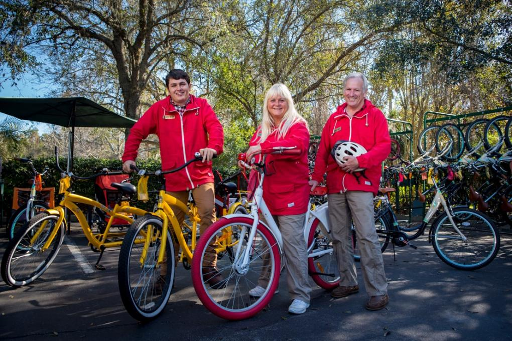 Family members stand near their bikes before riding them together