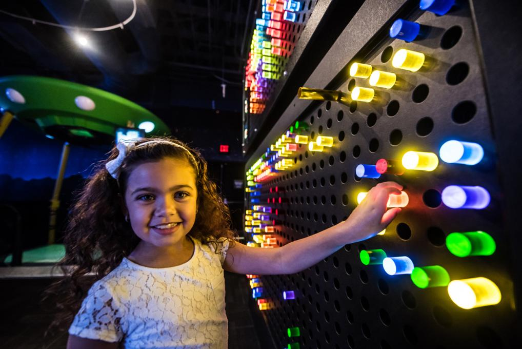 A Child Explores the Educational Exhibits at WonderWorks