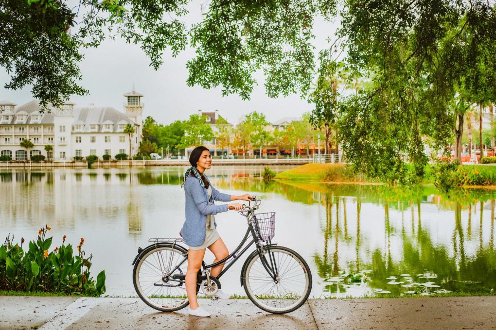 A lady bikes in Celebration