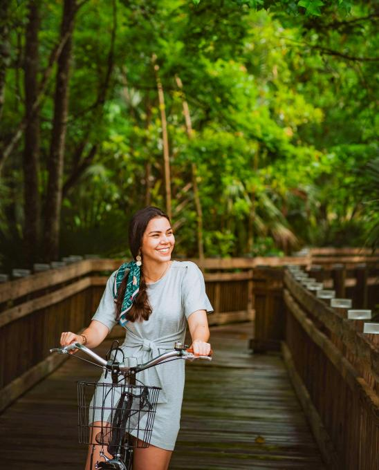 Izzy Rpse rides a bike at Celebration Bike Rental