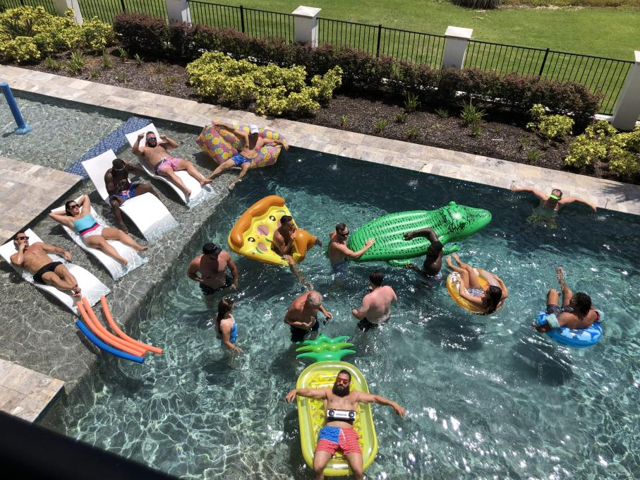 Men lounging on the lazy river
